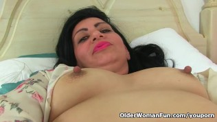 UK milf Candylips pleases her shaven cunt with a sex toy