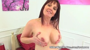 British milf Beau gets naughty in crotchless tights