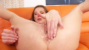 Olga fists herself hardcore and pees