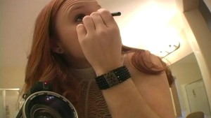 Redhead puts on makeup
