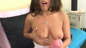 Brunette fills her pussy with giant dildos