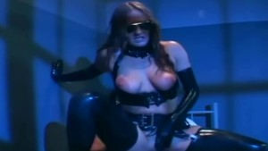 Kinky sex in a latex costume and shiny gloves