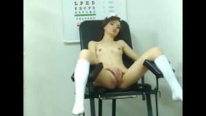 Hot brunette nurse plays with an orange dildo