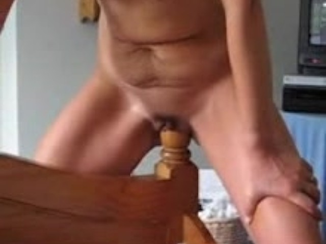 nude woman and bedpost