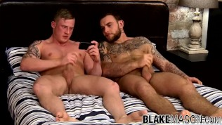 Two studs watch porn and jerk off together until they cum