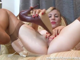 Sexy blonde Saffy fucks pussy with heels in vintage nylons and lingerie