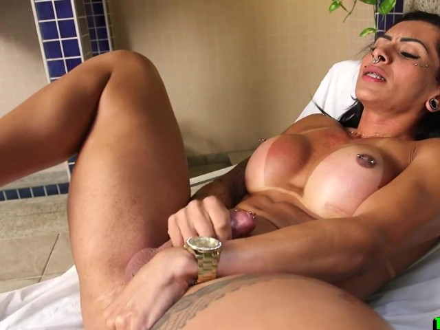 Big Tittied Tranny With Mouthful of Piercings