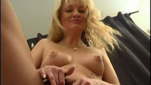 sexy blonde shoves an orange in her ass
