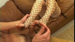 Her fishnet stockings jacks off his cock