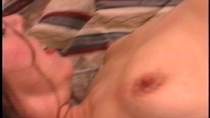 Licking and sucking her own tits