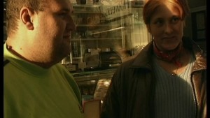 Big guy meets up with carefree redhead