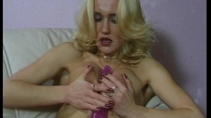 Blondie plays with her pink dildo