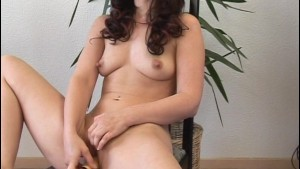 Brunette girl tests out some dildos