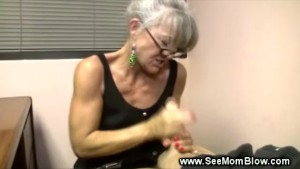 Mature milf wearing glasses tugs and sucks