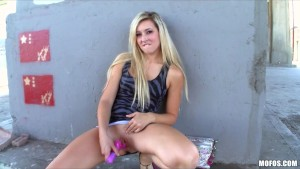 Horny blonde nympho Lilly Banks fucks her dildo in public