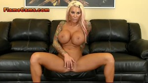 Hot, fit blonde MILF with tats fingers her pussy