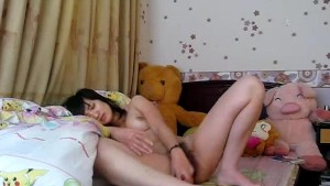 This Asian Teen Fingering Her Hairy Pussy
