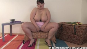 Chubby mature mom fucks herself with a dildo