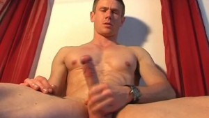 Jeremy, an athletic guy gets wanked his huge cock by a guy!