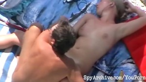 Blonde milf blows her hubby at the beach