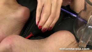 Busty Kira Queen pisses through her pantyhose