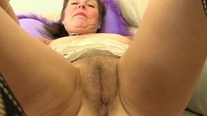 British granny Georgie fingers her ass