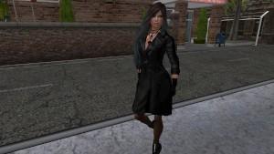 une jolie brune virtuelle en long manteau noir et bas collant noir