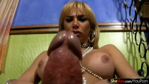 Latina shedoll with huge breasts plays with her monster cock