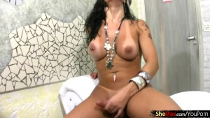 Tranny with tattooed back slips out of lingerie and tugs off