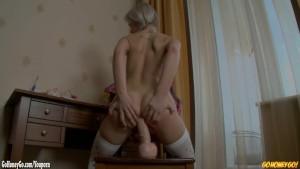 Young schoolgirl fucks her ass with huge dildo