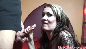 Amsterdam prostitute in nets plays with cum in mouth