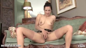 Hot brunette Chelsea French strips off and masturbates in stunning leopard print heels and in vintage nylons with a sheer garter belt