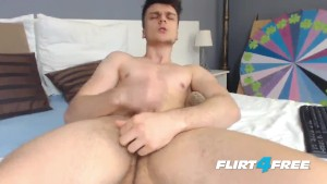 Hard Jerking Hunk Shoots a Big Load on Cam