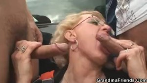 Old woman swallows two cocks in fields