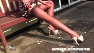 Milf Nylon Jane walking teasing in sexy pair of nylon stockings suspender belt and tall stilettos