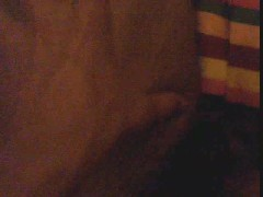 Man rubbing itself with oil on the bed