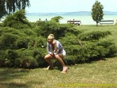 hot blonde girl peeing on the beach