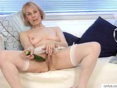 Horny Mature Granny fucks a cucumber