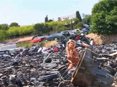Chloe brightens up a junk yard with her naked body