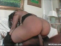Busty ebony whore rides a big black cock with her horny cunt