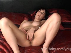 Young and hairy girl Olive opens up her hairy pussy