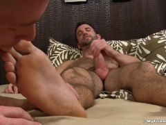 Bearded hunk jerks off while being feet worshiped and sucked