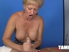 Breasty Mature Blonde Giving A Handjob