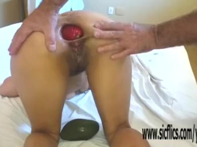 Women grabbing balls from behind