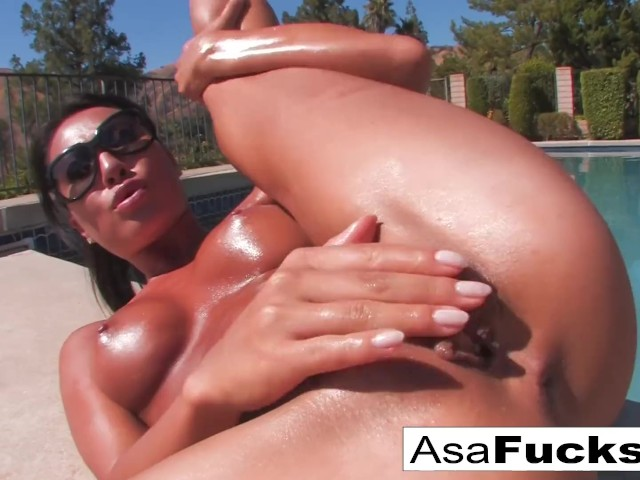 Asa Akira Lays Out by Her Pool and Gets Oiled Up