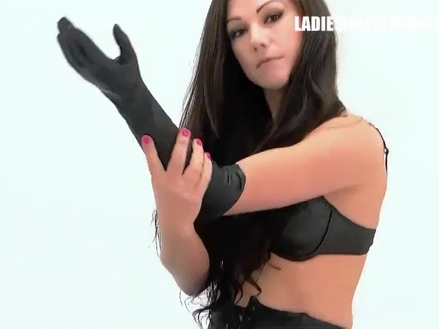 Kinky Babes Tina and Tia Tease Putting on Leather Gloves in Nylon Stockings and High Stiletto Heels