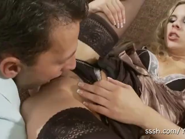 Woman in Lingerie and Lover Engage in Intense Foreplay