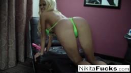 Big boob Nikita plays...