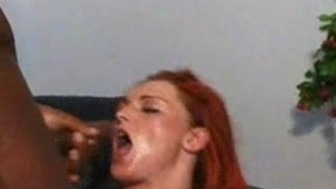 redhead gets stretched by 3 black cocks