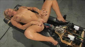 Beautiful blonde spreads legs for fuck machines